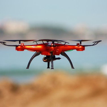 Quadrocopter flying on the beach