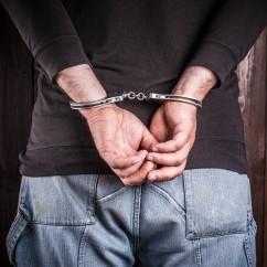 man hands in handcuffs